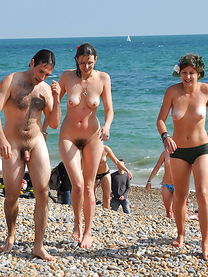 Horny wives lay on beach, they spread their legs showing pussy and ass hole to neighbours.